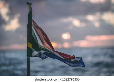 Sout African Flag blowing on the tail of a boat on the ocean
