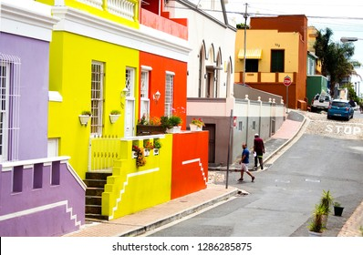 South Africa, Cape Town - 11 January, 2019: The street with colorful houses in Bo-Kaap. The daily scene of the Muslim Malay Quarter. British style buildings. The former township as a cultural heritage