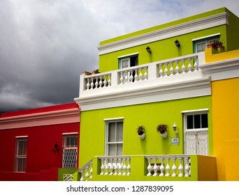 South Africa, Cape Town - 11 January, 2019: The brightly colored houses before the rain. Bo-Kaap, Cape Town. South African cityscape. The famous tourist attraction. British style colorful buildings.