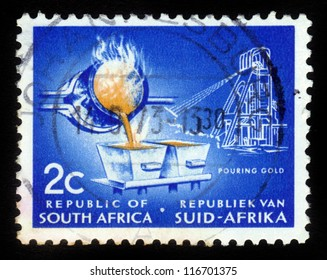 SOUTH AFRICA - CIRCA 1960: A stamp printed in South Africa, shows process of smelting gold, circa 1960