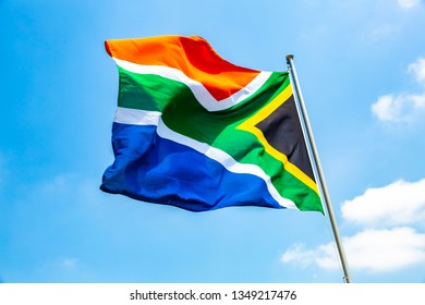 South Africa flag on the mast. South Africa flag with blue sky.