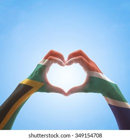 South Africa flag on woman hands in heart shape for national unity, union, love and reconciliation concept