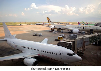 South Africa, Johannesburg - 12 January, 2019: Close-up Boeing 737, Boeing 787 airplanes at the JNB, Tambo International airport. The pre-flight checks. The jet bridge next to the airplane.