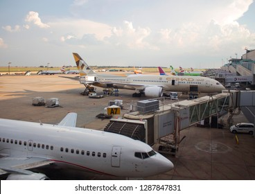 South Africa, Johannesburg - 12 January, 2019: Close-up jet bridge to the Boeing 737 airplane at the JNB, Tambo International airport. Boeing 787 by Etihad company on the background. Pre-flight checks