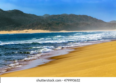 South Africa, KwaZulu-Natal province. iSimangaliso Wetland Park (Greater St. Lucia Wetlands Park, on UNESCO World Heritage Site) - sandy beach near St. Lucia town. Waves blur motion effect