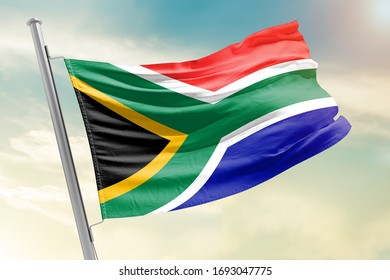 South Africa national flag cloth fabric waving on the sky with beautiful sky - Image