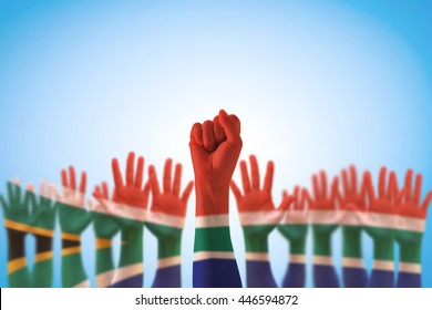 South Africa national flag pattern on leader's fist hands (clipping path)  for human rights, leadership, reconciliation concept