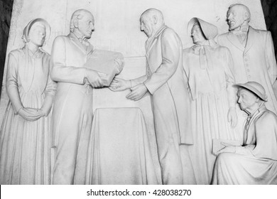 "South Africa, Pretoria - 28 June, 2015: Voortrekker monument. Bas relief "" British settlers present a Bible to Voortrekker leader Uys"" in the Hall of Heroes."