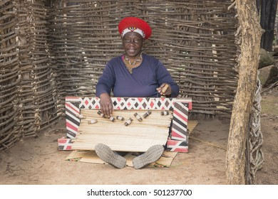 South Africa, Shakaland Cultural village- 29- September 2016. Married woman of the Zulu tribe weaving a blind crafts.