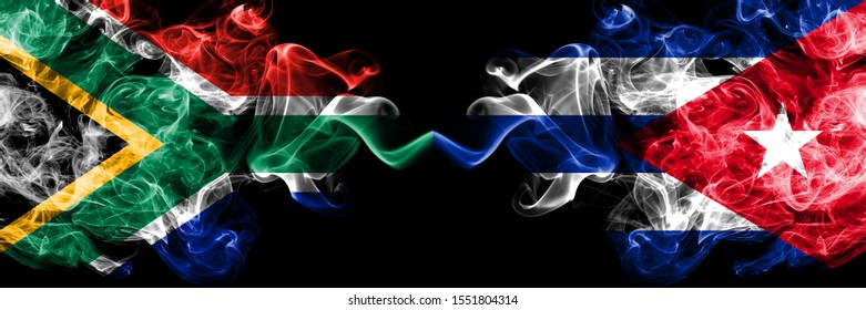 South Africa vs Cuba, Cuban smoky mystic flags placed side by side. Thick colored silky abstract smoke flags concept