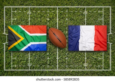 South Africa vs. France flags on green rugby field