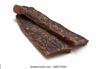 South African biltong (beef) isolated on a white background