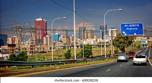 South African cities. Wonderful streets of beautiful Johannesburg. BRICS countries. CBD. Road infrastructure and modern view of Johannesburg. Johannesburg, South Africa - December 21, 2013