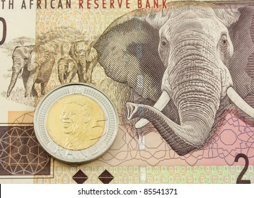 South African Currency - A Five Rand Coin with the bust Of Mandela on a Twenty Rand Note
