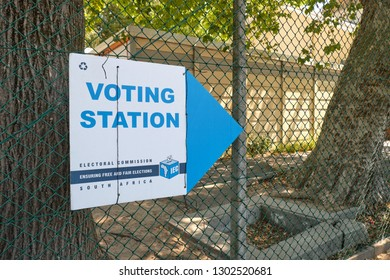 South African election voting station sign from the electoral commission, with the polling station in background.  Cape Town, South Africa -  Circa 2019