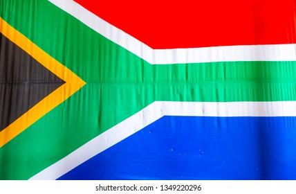 25e6e05dac0 South African Flag. South Africa flag waving with blue sky.