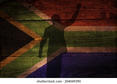 An South African flag on a grunge wooden background with a shadow overly for freedom.