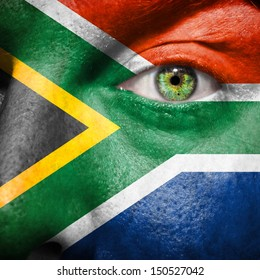 South African flag painted on a man's face to support his country South Africa
