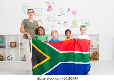 south african kindergarten teahcer and students with south africa flag