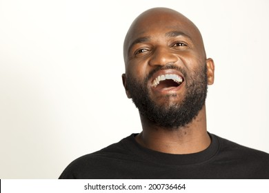 South African man on plain background.