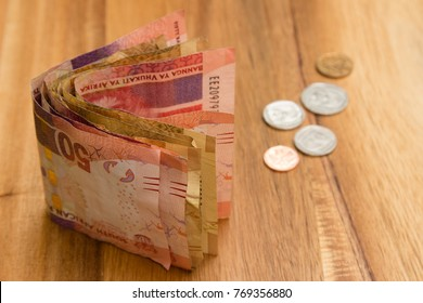 A South African money concept image consisting of a stack of rand notes and coins.