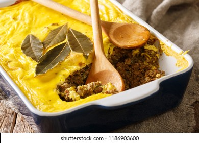 South African traditional food Bobotie baked curry ground meat with whipped eggs close-up in on the table. horizontal