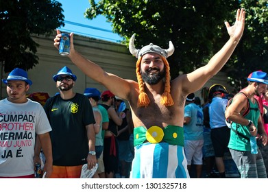 South America, Brazil - February 19, 2017: Disguised reveler smiles for the camera during a pre carnival street party in Rio de Janeiro.