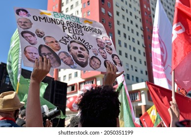 South America, Brazil – July 24, 2021: Marchers gathered in central Rio de Janeiro with signs and banners to protest against Brazilian far-right president Jair Bolsonaro and tell him they want him out