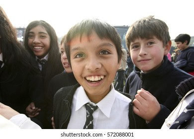 SOUTH AMERICA, CHILE, year 2009: indigenous Chileans, children, high school students on the street, joyful