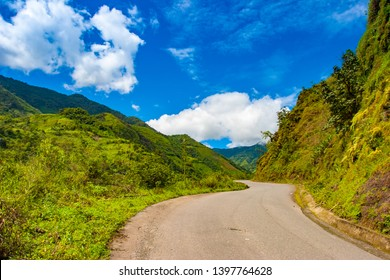 South America. Ecuador. Andes mountains covered with greenery. An asphalt road through the Andes. Mountain landscape of Ecuador. Travelling by car in Ecuador.
