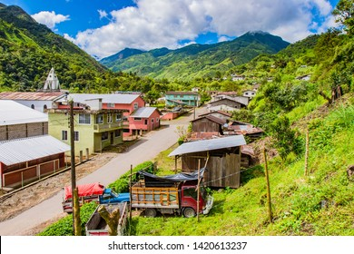 South America. Ecuador. Ecuador village in the lowlands of the Andes. Ecuadorian rural settlement. Andes mountains greenery covered. Mountain landscape of Ecuador. Travelling to South America.