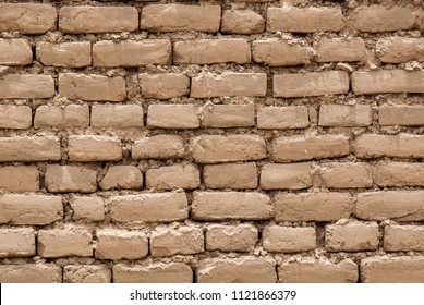 South America, Peru, Trujillo, Salaverry. Chan Chan, largest adobe city, 1000 year old capital of Chimu Kingdom. Old adobe brick wall detail for Background or Texture. Macro shot.