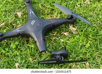 South Australia, Australia - July 19 2018: View of a broken Q7 FY326 quadcopter on green grass.