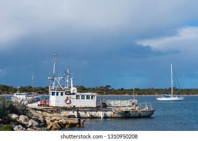 South Australia, Australia - July 30 2017: Working boat with yacht at American River's harbour on Kangaroo Island.