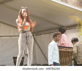 South Australia, Australia - September 12, 2015: A female singer performs at the Unmasked Africa Festival in Victoria Square, Adelaide.