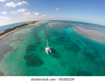 South Bimini, Bahamas - a sailing catamaran at anchor in the Bahamas