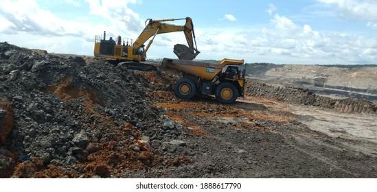 South Borneo, INDONESIA - NOVEMBER 23, 2020 : Coal mining activities, coal getting, hauling and loading at a coal mining company in PT. Kalimantan Prima Persada.