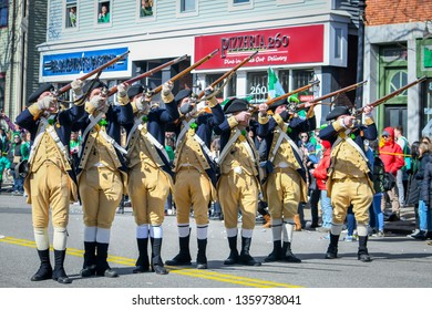 South Boston, MA - 3/17/19: Colonial minutemen aim their muskets in the St Patricks Day Parade