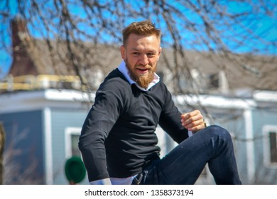 South Boston, MA - 3/17/19: MMA fighter Conor McGregor rides atop a car in the St Patrick's Day Parade