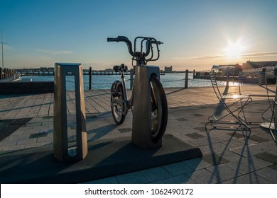 South Boston, Massachusetts, USA - April 14, 2016: Early morning at Hubway bike sharing station at Fan Pier Park in Seaport District of South Boston