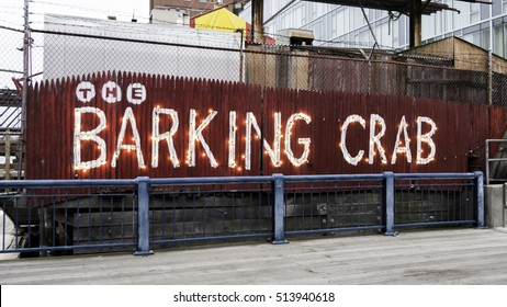 South Boston, Massachusetts, USA - December 17, 2015: Casually creative sign announces the location of The Barking Crab, a popular restaurant along the Harborwalk in South Boston