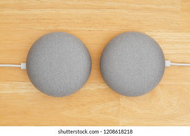South Carolina, USA Oct 2018. Illustrative editorial image of two Google home devices on a wood desk