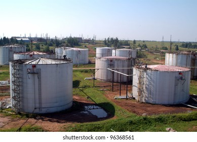 SOUTH CENTRAL RUSSIA - JULY 26: Storage tanks and transmission facilities at TNK-BP's Udmurtia oil fields on Tuesday, July 26, 2005 in south-central Russia