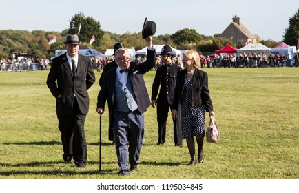 South Cerney Airfield, Gloucestshire Sept 2018. Vintage fair. Winston Churchill (lookalike) walking around with vintage police at vintage event with cigar and bowler hat.