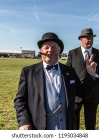 South Cerney Airfield, Gloucestshire Sept 2018. Vintage fair. Isolated image of Winston Chruchill lookalike smoking cigar and showing vitory sign.