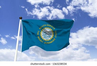 South Dakota flag mockup in the wind. The symbol of South Dakota. The flag of South Dakota as a symbol. Flag of the State of South Dakota. Flag of the USA state.