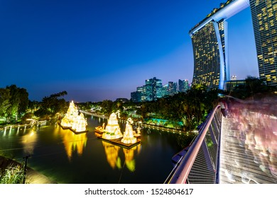 South East Asia, Singapore, September 06th 2019 : Cityscape landmark night long exposure view of Marina Bay Sands Casino Hotel building surrounding environment