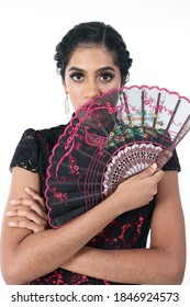 South east Asian Indian race ethnic origin woman wearing Chinese dress costume Cheongsam holding hand fan multiracial community on white background