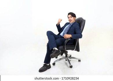 South east Asian Malay Man facial expression sit on chair confident smile