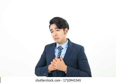 South east Asian Malay Man facial expression sad upset hand tied on chest